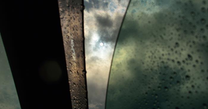 Crack open window with raindrops