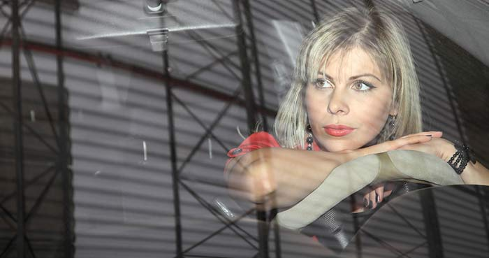 Woman looking out windshield